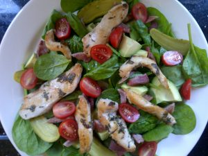 Herby chicken strips on a mixed salad