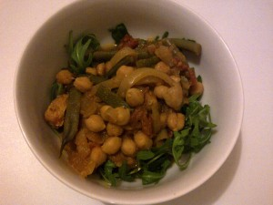 slow-cooked herb chicken and chickpea stew on a bed of rocket